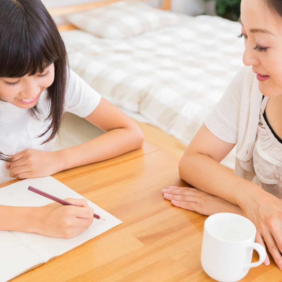 parent with intermediate child doing homework